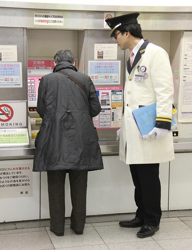 Station attendant standing by to help those in need (he speaks English)